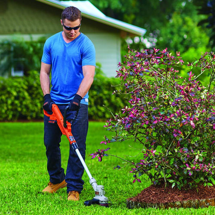 man using the Black and Decker LST300 String Trimmer