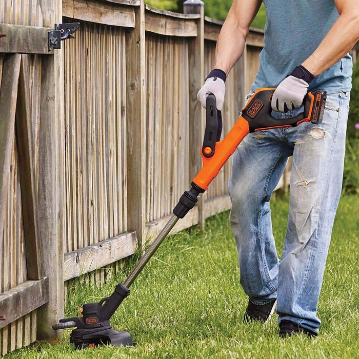 Black and Decker LST522 String Trimmer being used in the back yard
