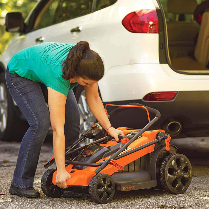 woman unpacking the Black and Decker MM2000 Electric Lawn Mower