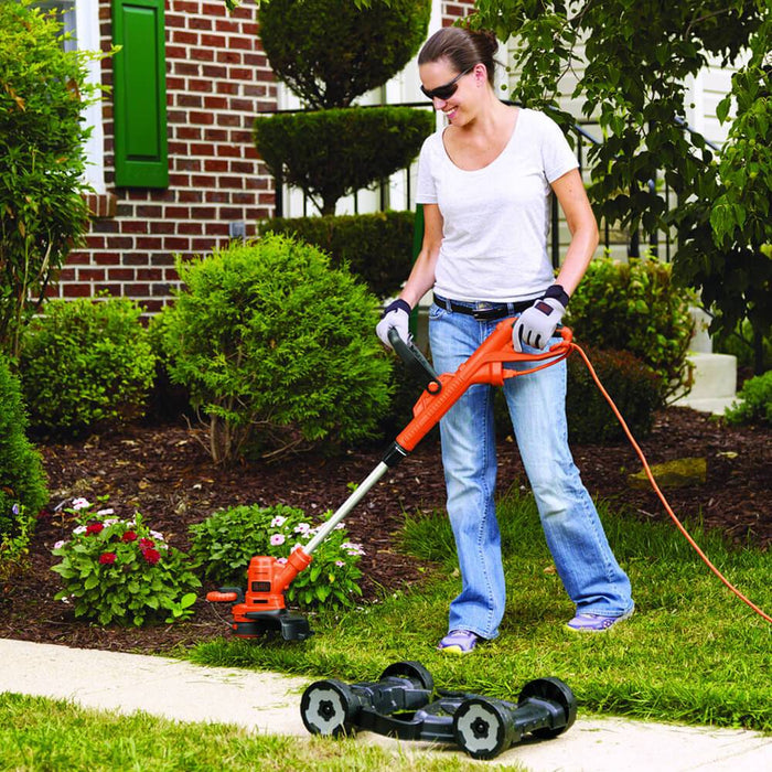 woman using the Black and Decker MTE912 Trimmer Edger Mower as a trimmer