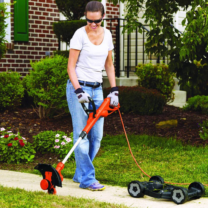 woman using the Black and Decker MTE912 Trimmer Edger Mower as a edger