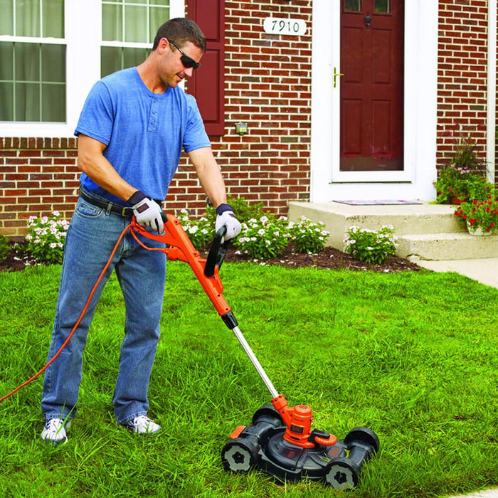 man using the Black and Decker MTE912 Trimmer Edger Mower on the lawn