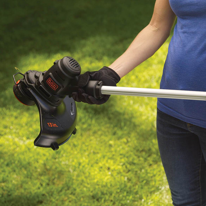 woman holding Black and Decker ST8600 String Trimmer