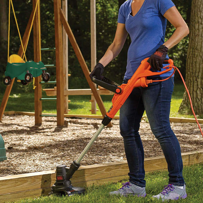 woman using the Black and Decker ST8600 String Trimmer