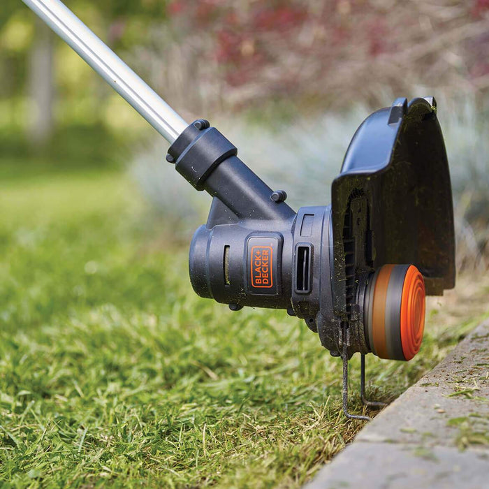 using the Black and Decker ST8600 String Trimmer on the side walk