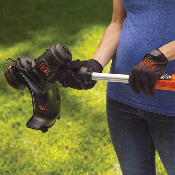 woman posing with Black and Decker ST8600 String Trimmer