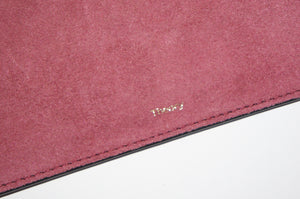 Theory Transformer Claret linden leather clutch