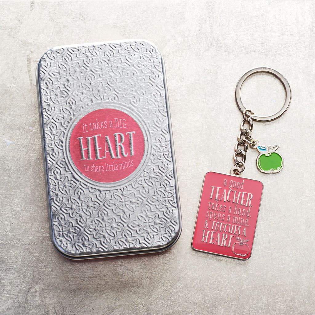 A Good Teacher Takes A Hand Pink (Keyring In Tin)
