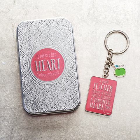 Load image into Gallery viewer, A Good Teacher Takes A Hand Pink (Keyring In Tin)