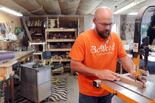 TJ Bowen cuts a piece of walnut to make a spurtle, one of BoWood's signature kitchen utensils, in BoWood's shop in Vinton.