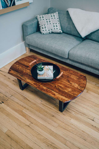 This gorgeous chechen coffee table features a rich and uniquely colorful finish in a simple and refined style, perfect for your home.