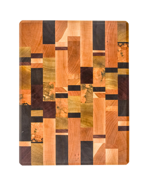 This end grain cutting board features a rich and colorful combination of exotic hardwoods in a unique random pattern.