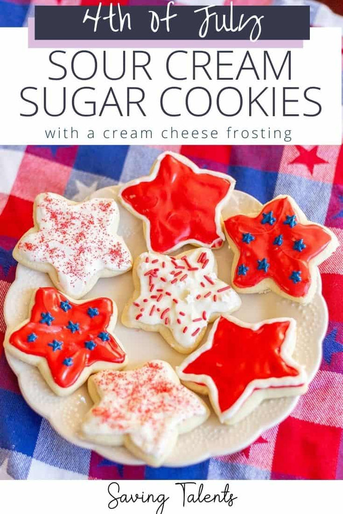 4th of july themed sour cream cookies shown on a plate on plaid red white and blue tablecloth