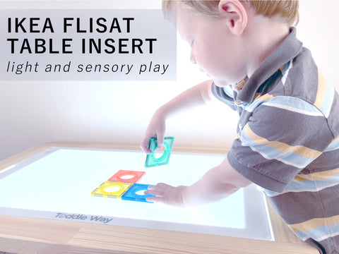 Child playing with IKEA Flisat table light pad