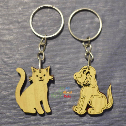 Image of Key Chain Wooden Carved cat shape and dog shape available at allaboutpets.pk in pakistan.