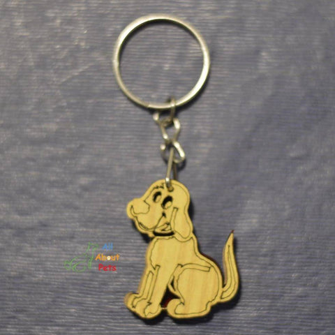 Image of Key Chain Wooden Carved dog shape available at allaboutpets.pk in pakistan.