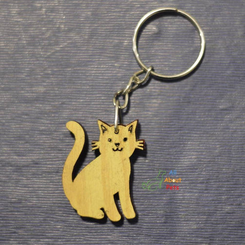 Image of Key Chain Wooden Carved cat shape available at allaboutpets.pk in pakistan.