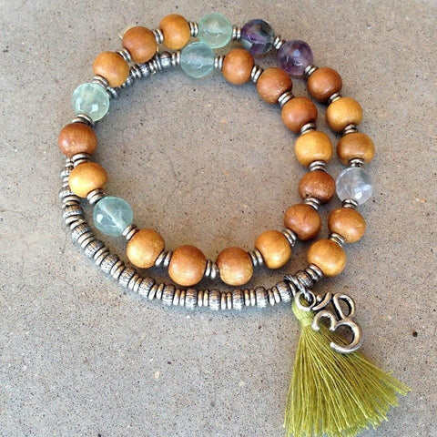 Sandalwood and Fluorite 27 bead wrap mala bracelet™ with Om charm and tassel