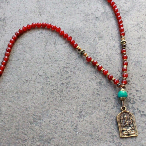 108 mala carnelian beads, with a Tibetan capped turquoise bead and Shiva pendant