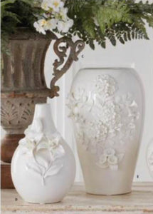 White ceramic bottleneck vase w/ raised flowers