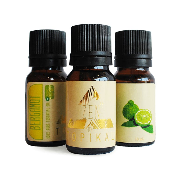 Several bottles of Topikal Zen CBD Essential Bergamot Oil with 100mg of hemp-derived CBD per 10ml bottle.