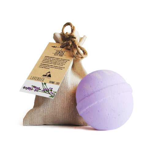 A Lavender CBD bath bomb sitting outside its hemp cloth bag.