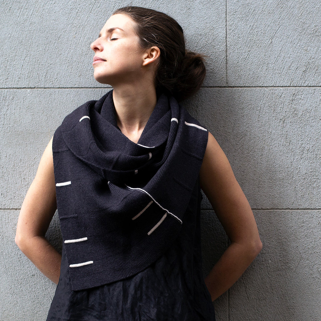 Knitted charcoal infinity scarf with cream stripes