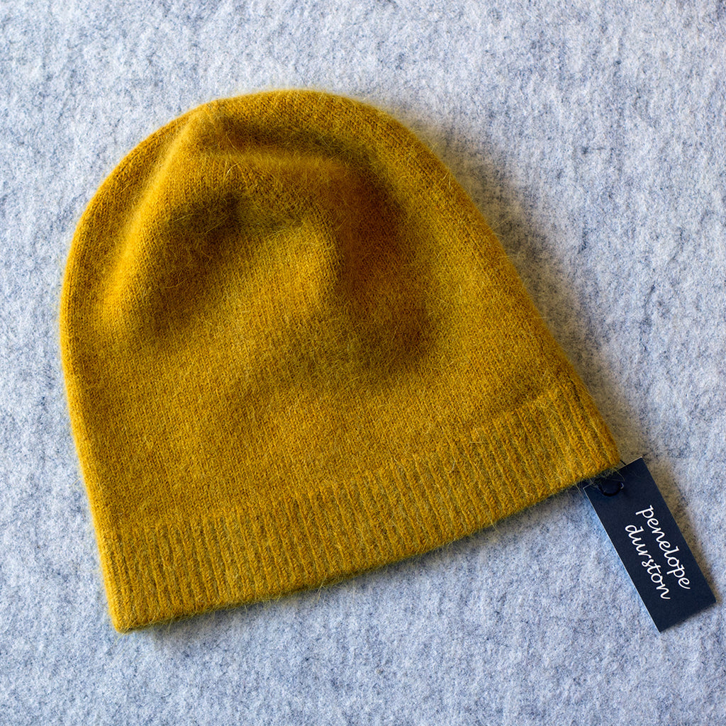 Mustard coloured beanie made from angora and lambswool