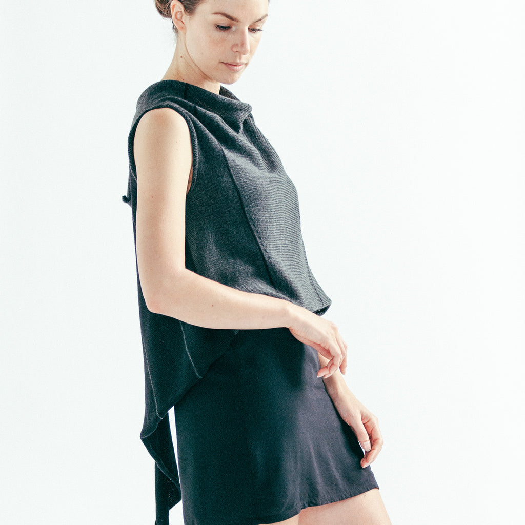 Side front view of Two Toned Self Curling vest in charcoal and black, worn back to front showing stripe detail and asymmetric hem