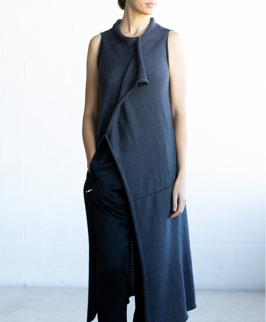 Front full length view of Asymmetric Longline vest design by Wendy Voon knits in charcoal merino wool