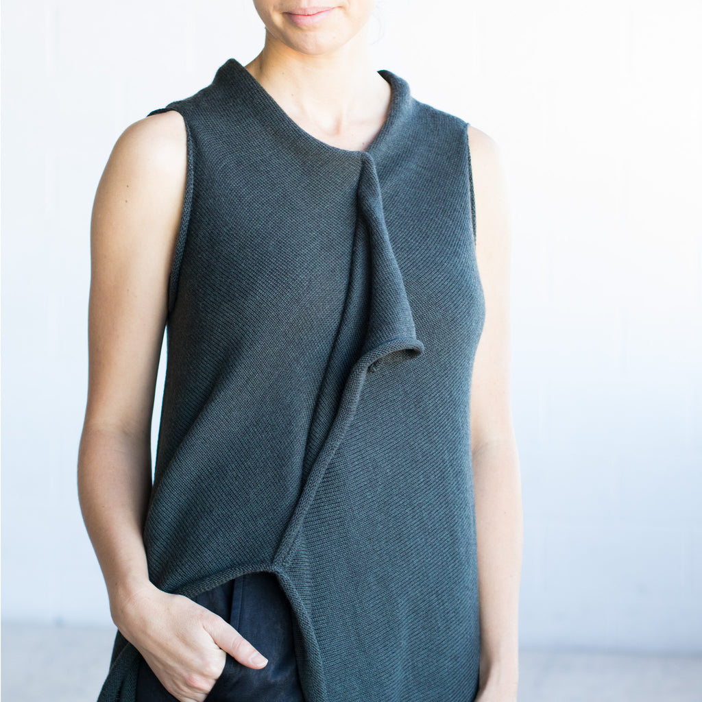 Front detail view of Asymmetric Longline vest design by Wendy Voon knits in deep forest green merino wool