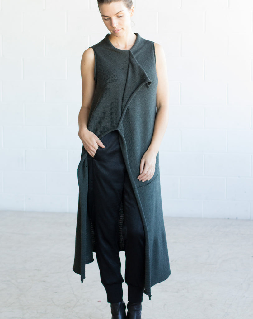 Front full length view of Asymmetric Longline vest design by Wendy Voon knits in deep forest green merino wool