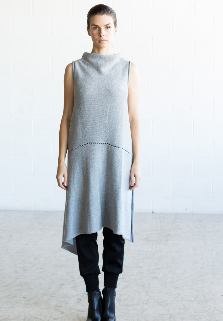 Front view of Asymmetric Longline vest design in silver grey melange merino, worn back to front with seam and stitch detail