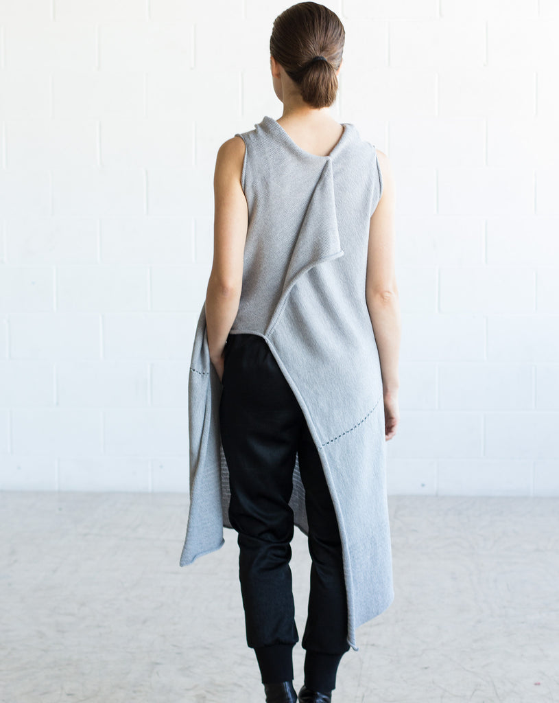 Back view of Asymmetric Longline vest design in silver grey melange merino, worn back to front with seam and stitch detail