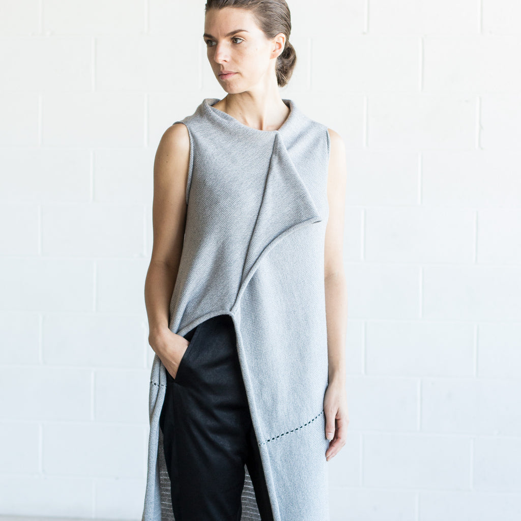 Front detail view of Asymmetric Longline vest design by Wendy Voon knits in silver grey melange merino wool