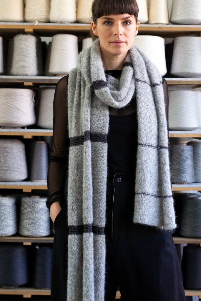 Full length view of alpaca striped wrap designed by Wendy Voon knits in silver grey alpaca with eggplant linen stripes