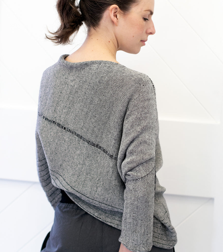 Back view of Bias Jumper design by Wendy Voon knits in silver grey linen backed with black merino wool