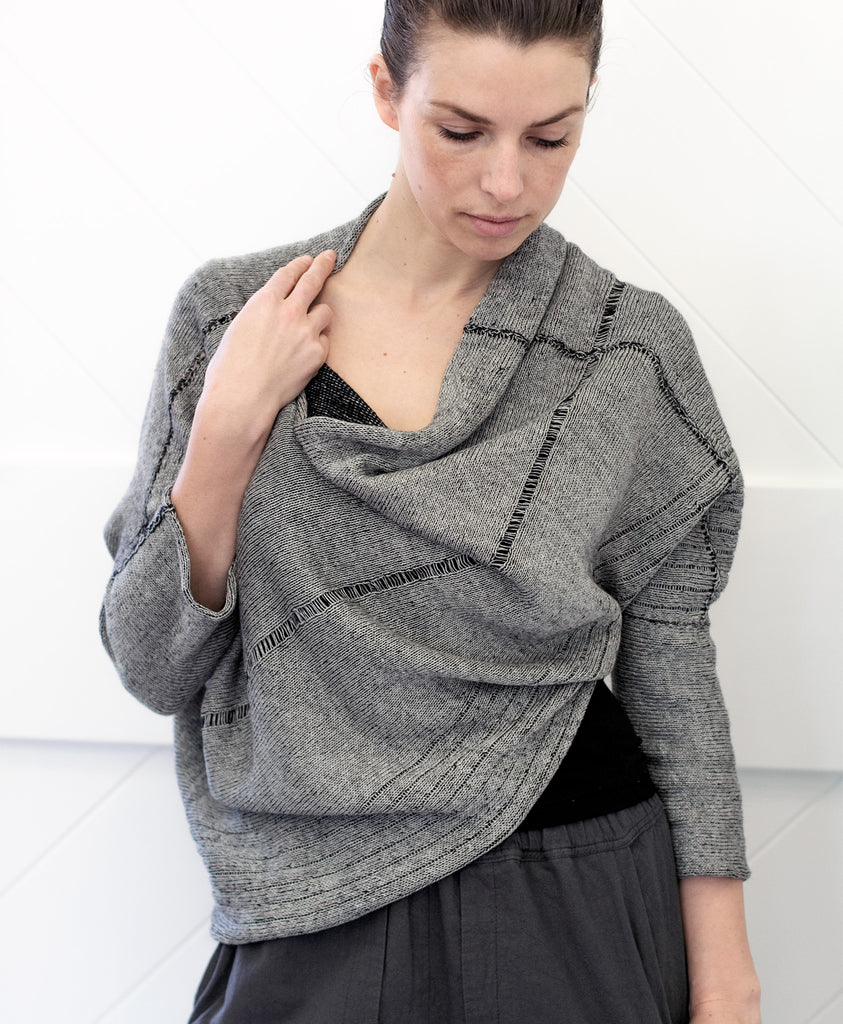 Front view of Bias Jumper design by Wendy Voon knits in silver grey linen backed with black merino wool