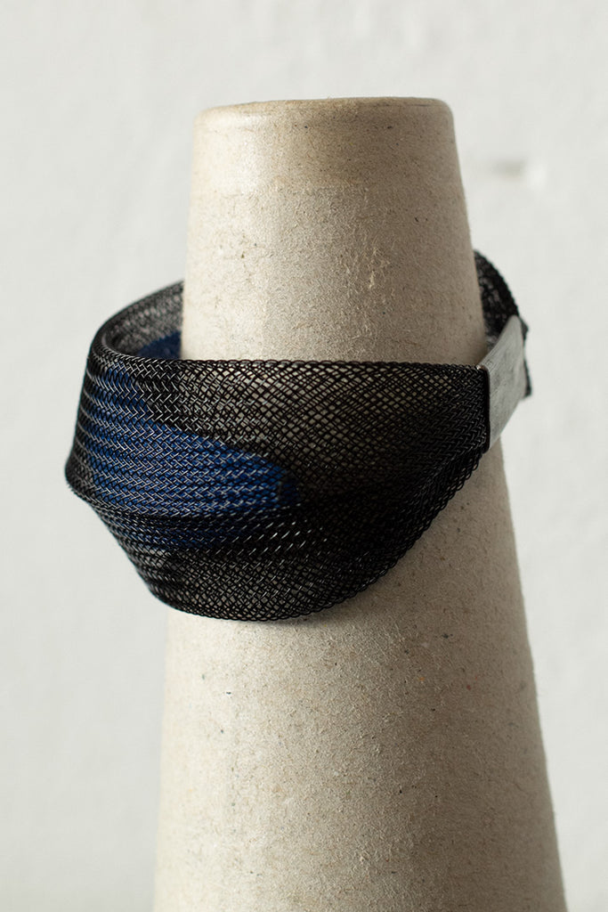 Blue inside black bangle side view