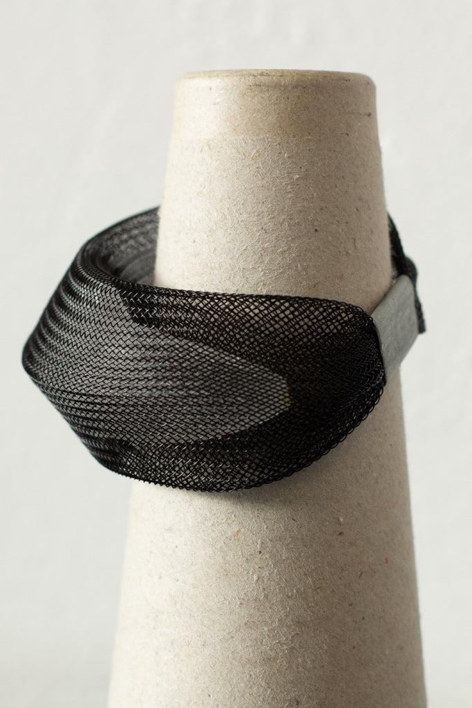 White inside black bangle side view