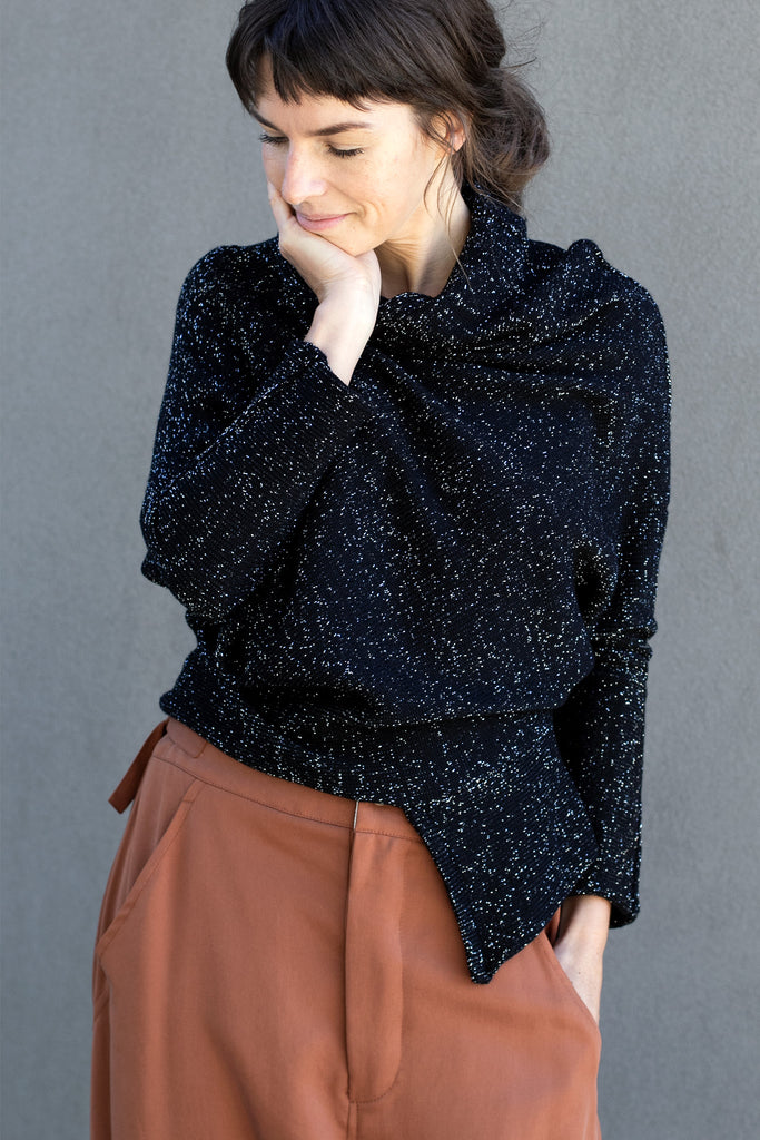 Front view of Bias jumper, a design by Wendy Voon knits in a sparkly black  merino wool and lurex blend fabric.