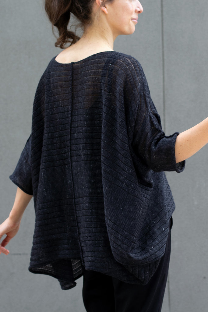 Back view of tulip shaped top in charcoal flecked linen and merino wool blend, designed by Wendy Voon.