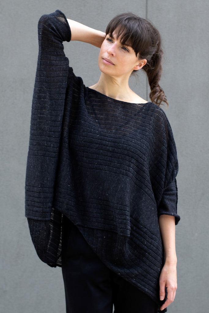 Front view of tulip shaped top in charcoal flecked linen and merino wool blend, designed by Wendy Voon.
