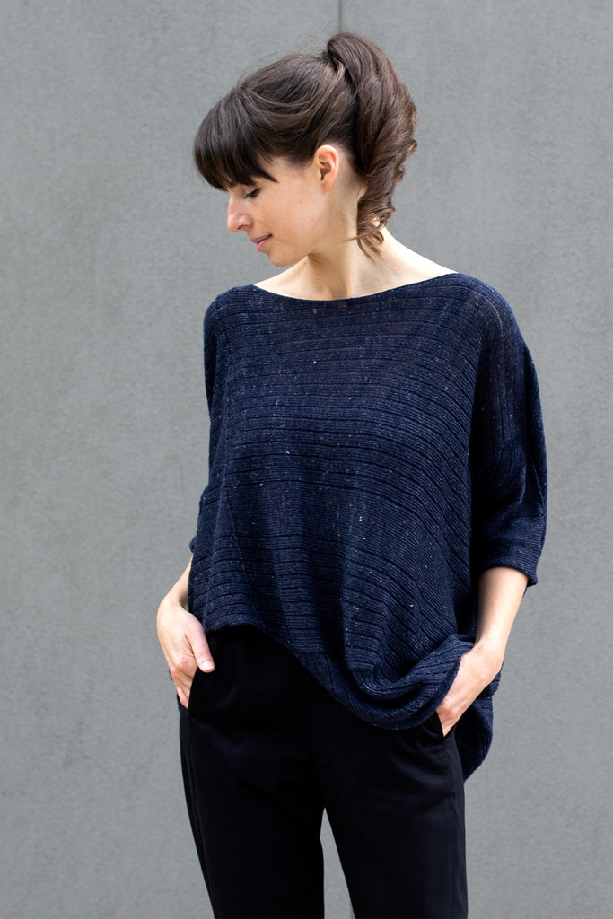 Front view of tulip shaped top in dark denim flecked linen and merino wool blend, designed by Wendy Voon.
