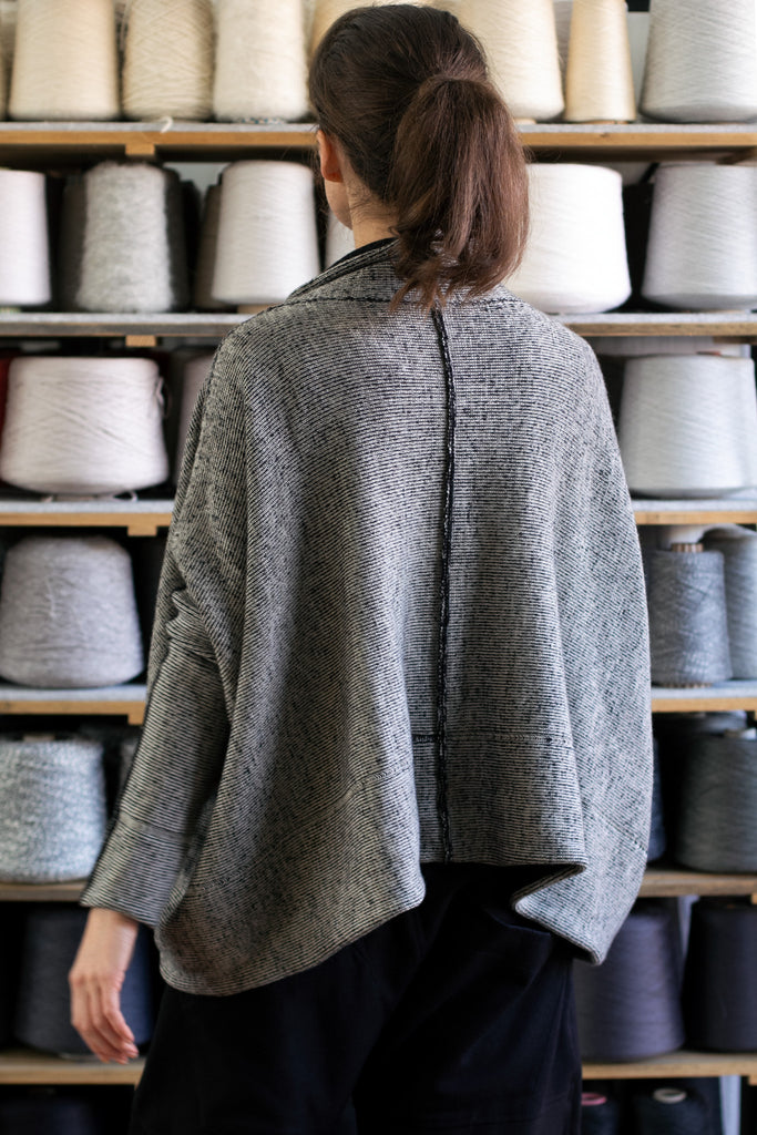 Back view of reversible box shaped jumper designed by Wendy Voon, made from superfine merino wool, with cream colourway showing.