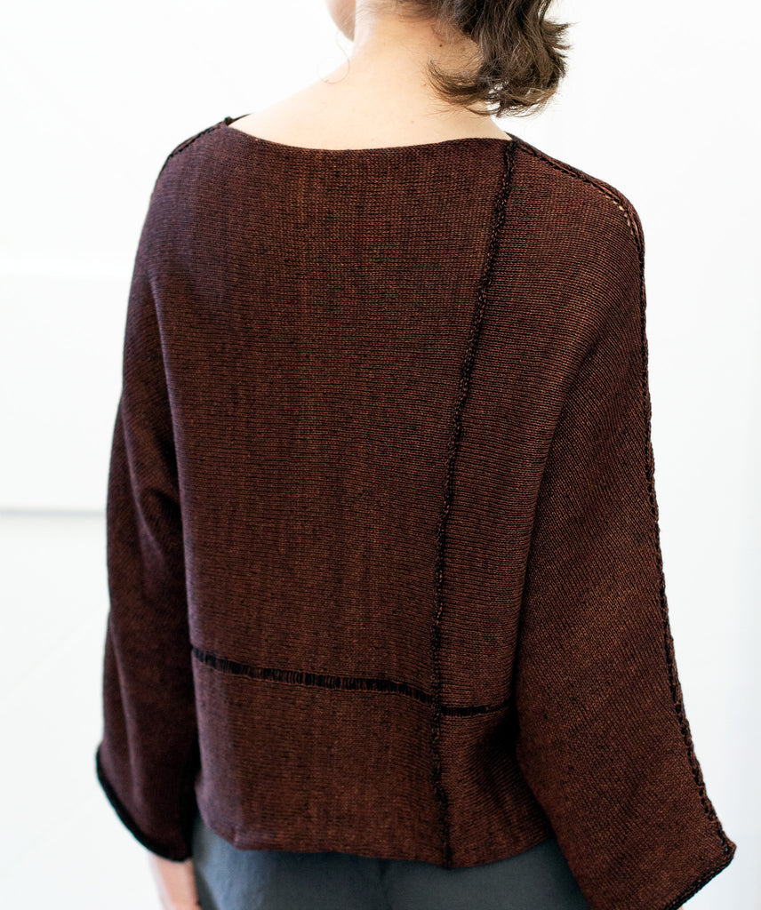 Back view of Cabled Linen & Merino Batwing design by Wendy Voon in rust linen cotton backed with black merino wool