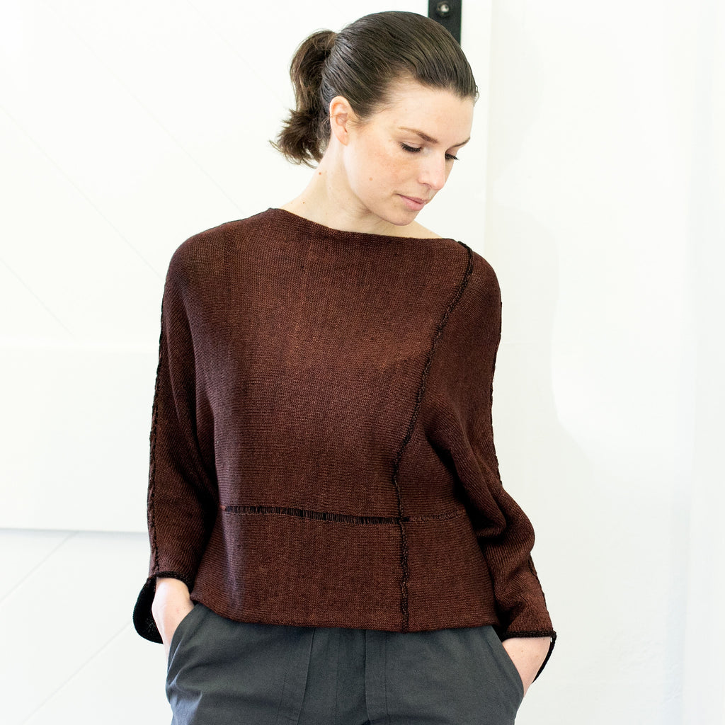 Front view of Cabled Linen & Merino Batwing design by Wendy Voon in rust linen cotton backed with black merino wool