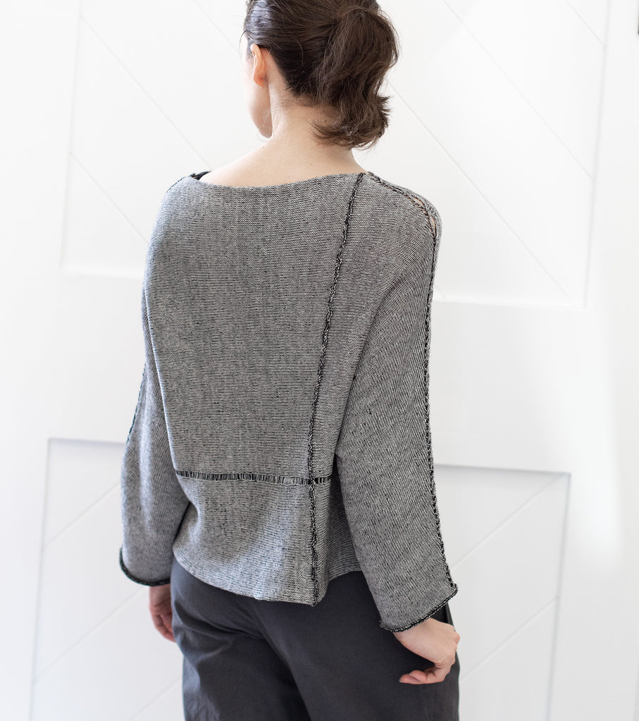 Back view of Cabled Linen & Merino Batwing design by Wendy Voon in silver grey linen cotton backed with black merino wool