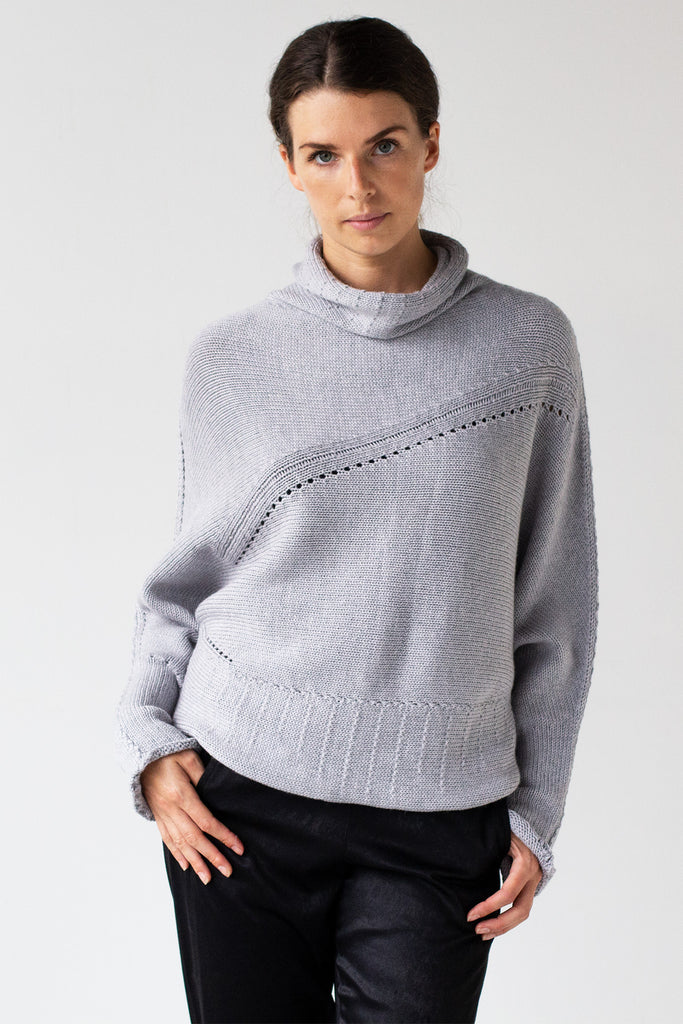 Front view of Chunky Funnel Neck Batwing jumper design by Wendy Voon knits in silver grey merino wool