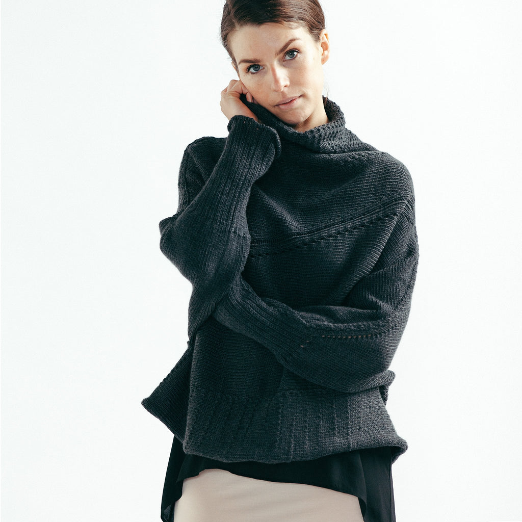Front view of Chunky Funnel Neck Batwing jumper design by Wendy Voon knits in charcoal merino wool